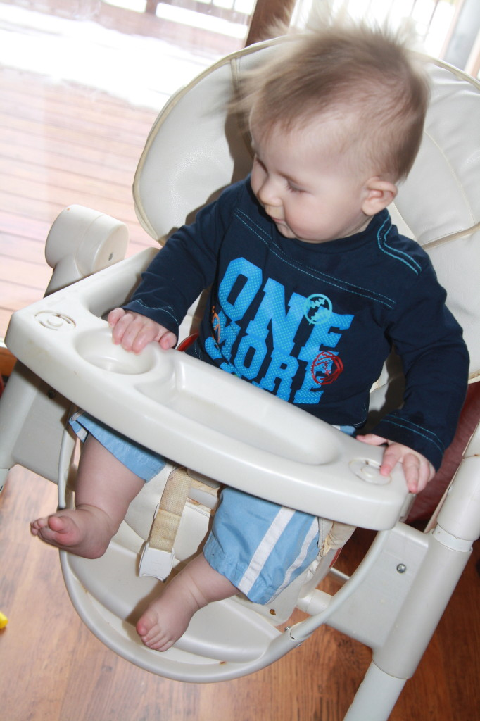"""Jake rocking out in his """"white high chair."""""""